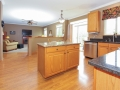 Big island with plenty of work surface and custom granite countertops throughout kitchen