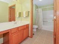 Upstairs hall bath with shower/tub and commode in separate, private area