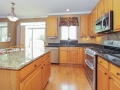 Gourmet kitchen with double oven and all stainless appliances