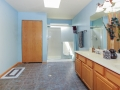 Custom designer tile floor, large shower, and big linen closet in master bathroom